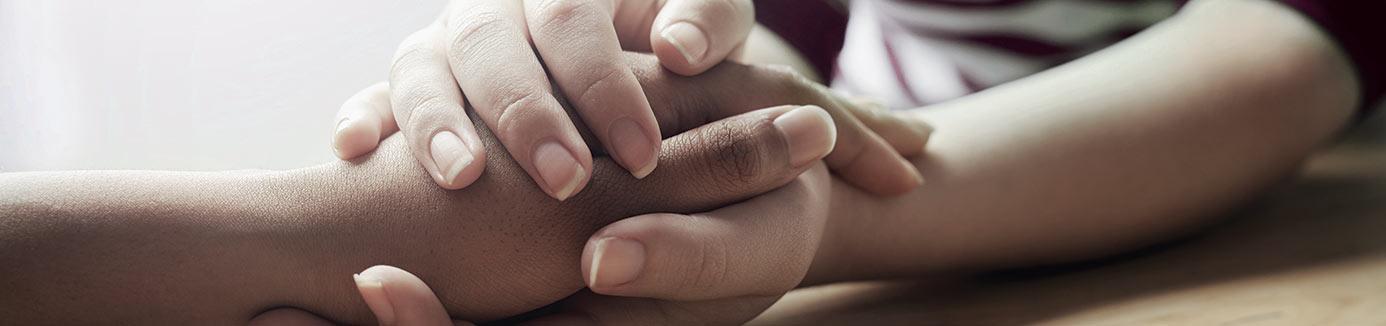 behavioral health specialist holding patient's hands