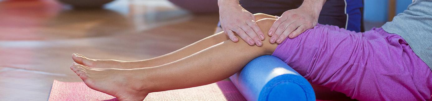 Patient getting massage on her knee
