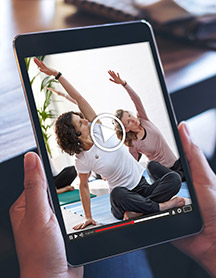 Ipad with women doing yoga on the screen
