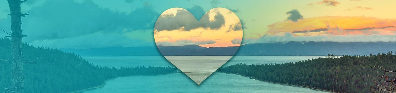 Heart superimposed over lake tahoe sunrise