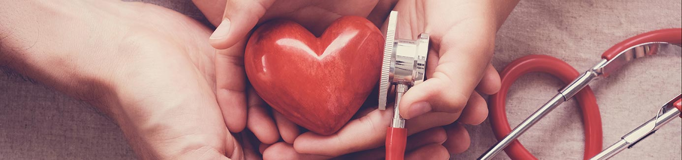 hands holding a heart and stethoscope
