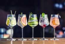 Five mocktails lined up at a bar
