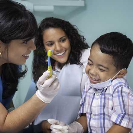 Child receiving a flouride treatment