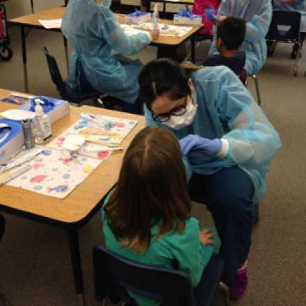 Child receiving a dental checkup