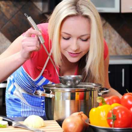 woman tasting sauce