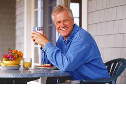 Man eating breakfast and smiling