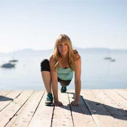 Nancy Brest on dock doing a lunge