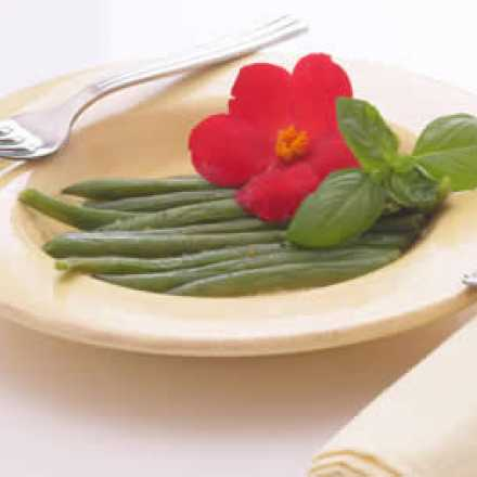 Green beans on a plate with flower garnish