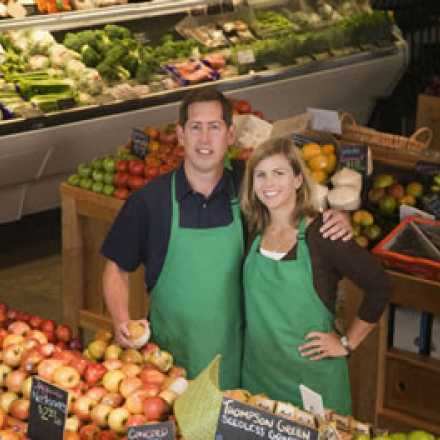 Couple in a grocery store produce section