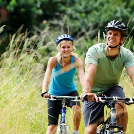 Couple mountain biking