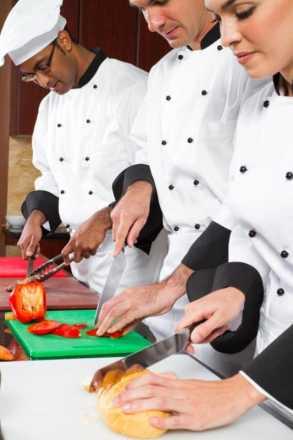 Chefs preparing food in a kitchen