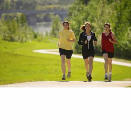 Three women running in a park