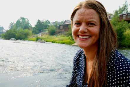 Elisa Chapman standing near the Truckee River