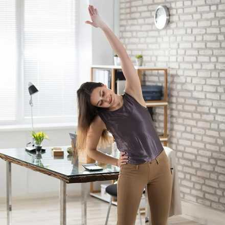 Woman stretching in her house