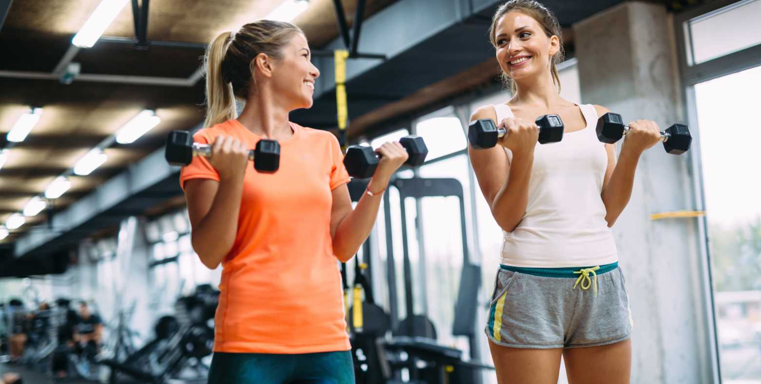 women lifting weights in the gym