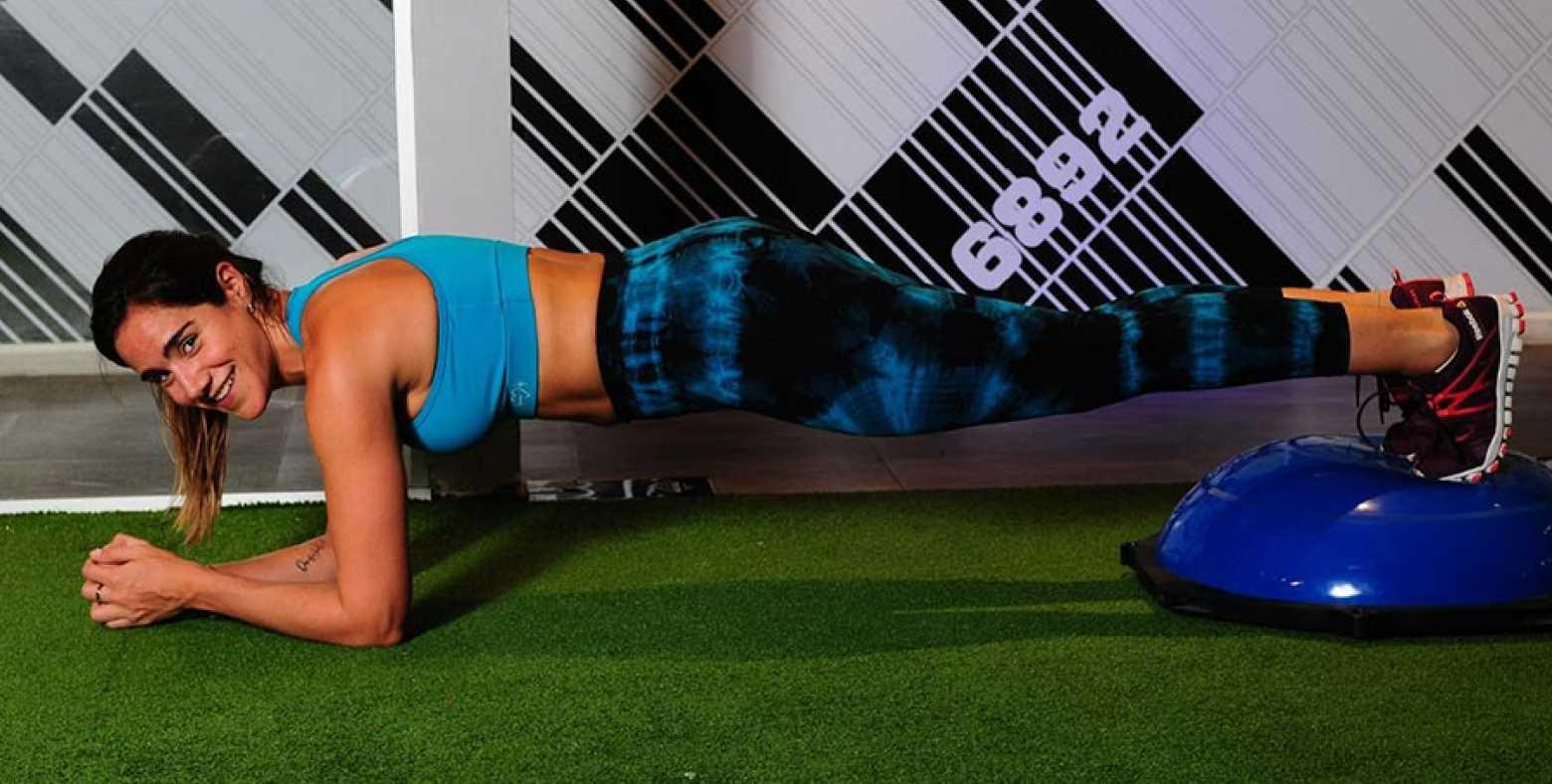 Woman doing body weight workout on bosu ball