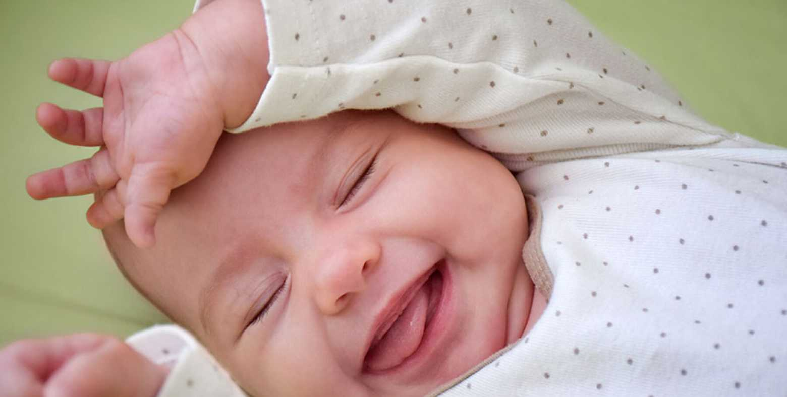 Happy baby laying down