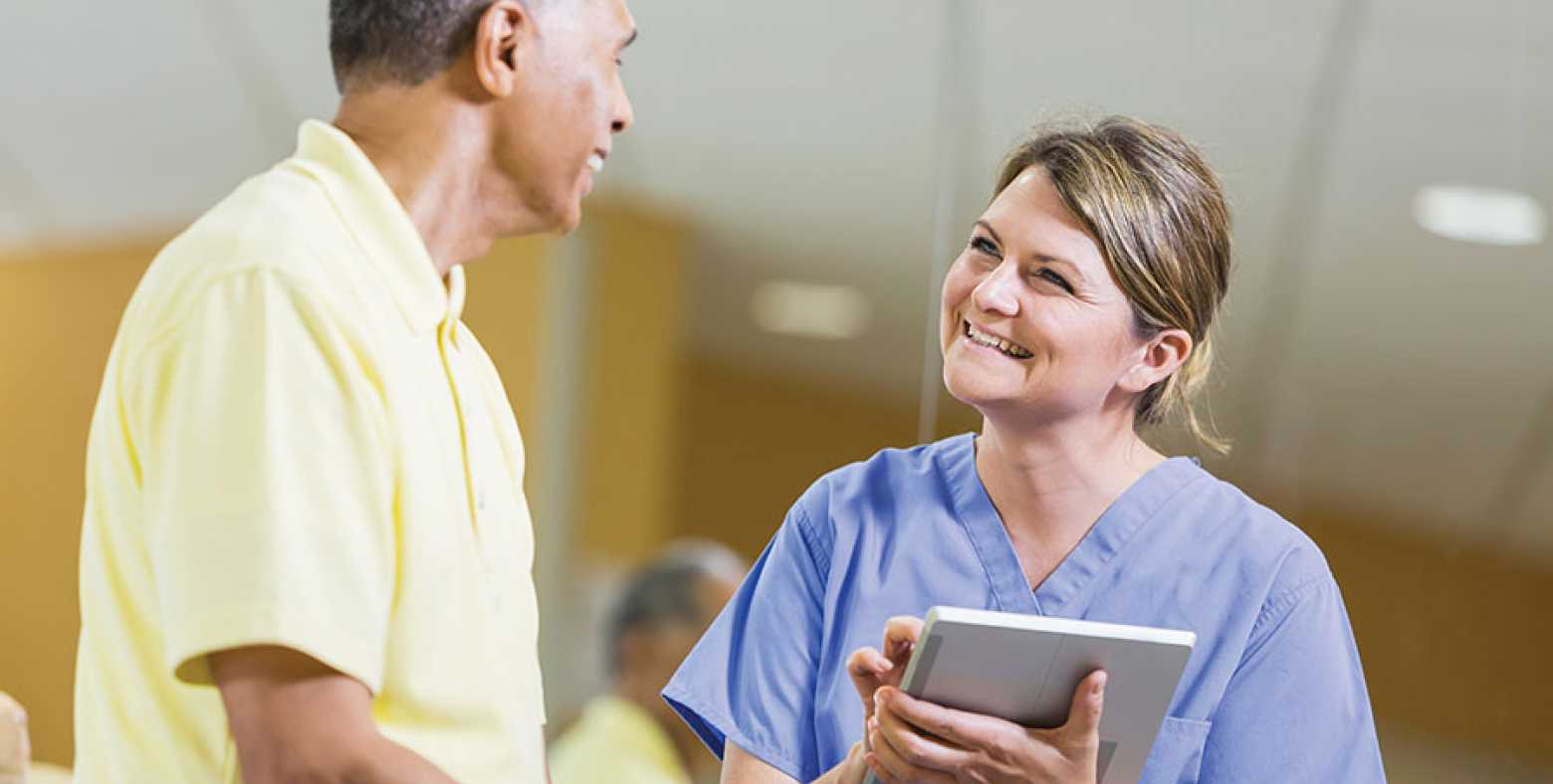 A female nurse speaking with a patient