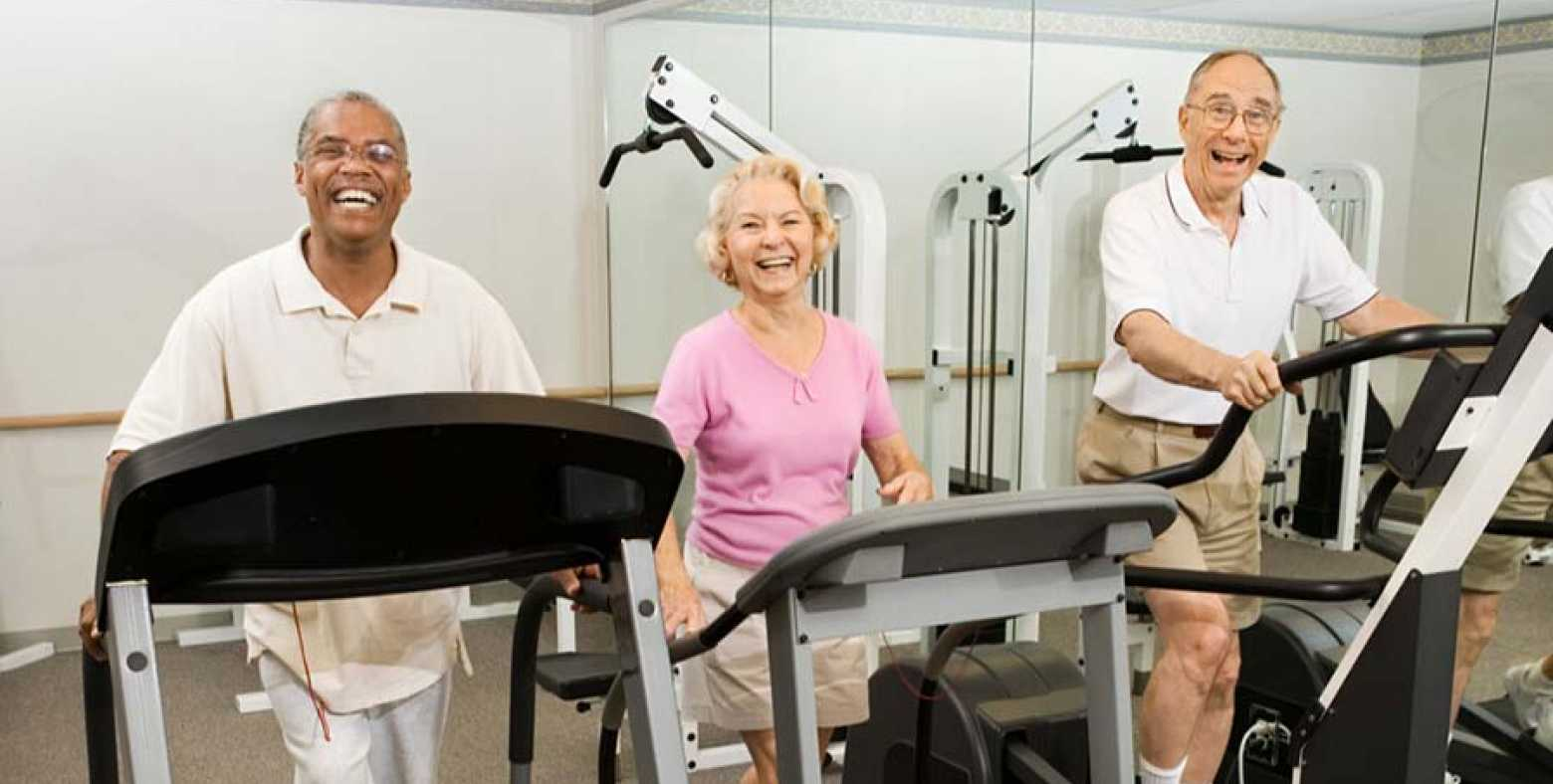 Adults exercising on treadmill