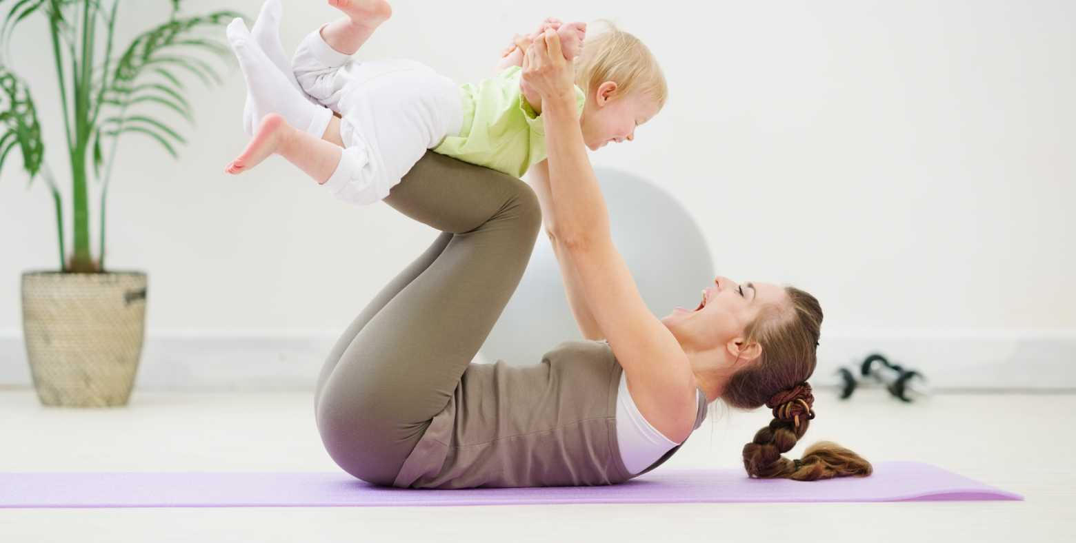 mom and baby on exercise mat