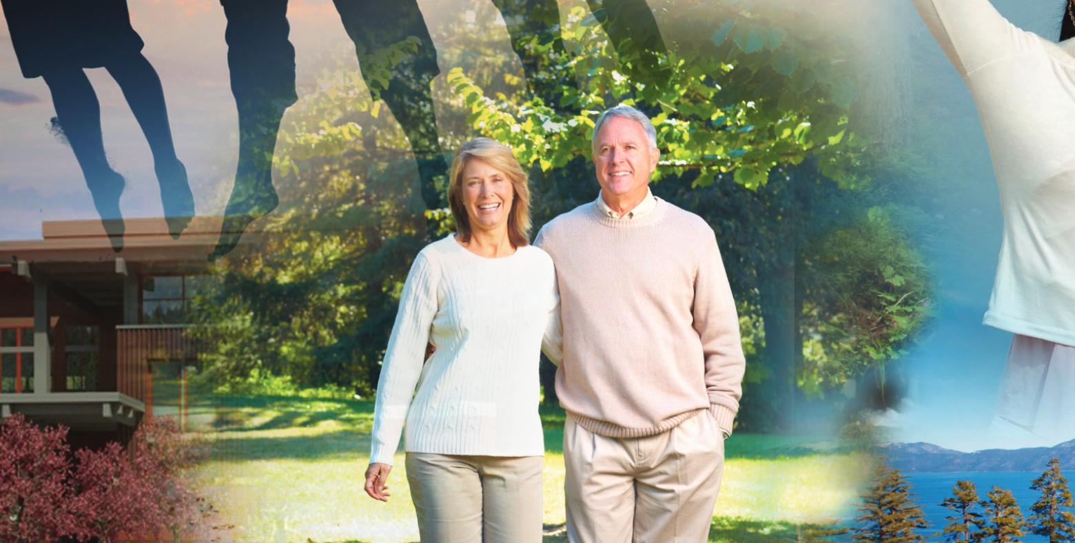Older couple walking through a park