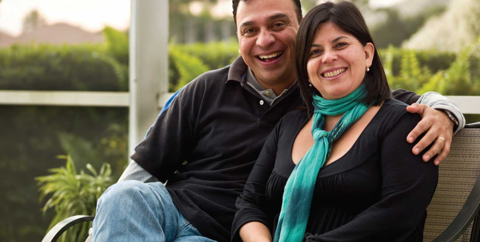smiling couple sitting together