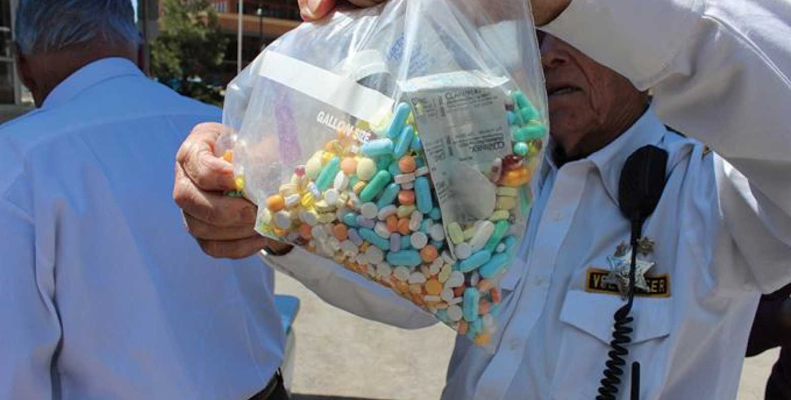 gentleman holding bag of prescription collected from drug take back days