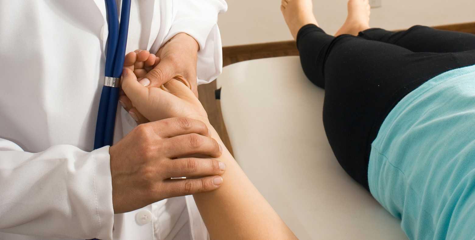 Nurse checks patient's pulse