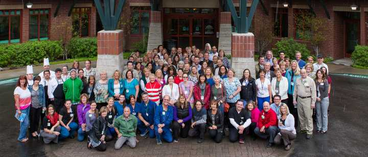 Huge group of Tahoe Forest Hospital staff in front of hospital
