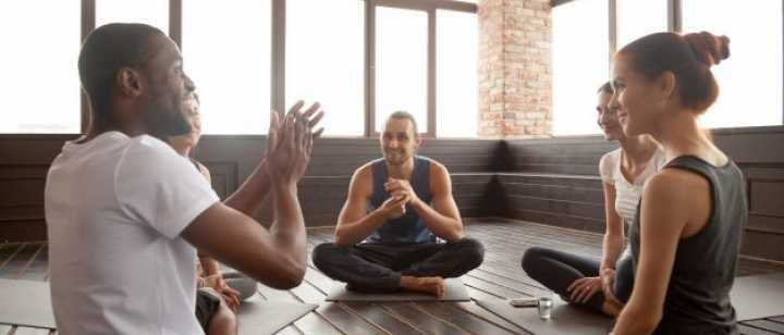 group sitting in circle in studio talking