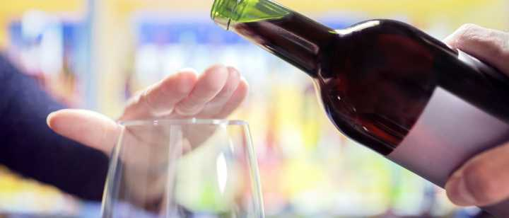 hand signaling not to pour wine in glass