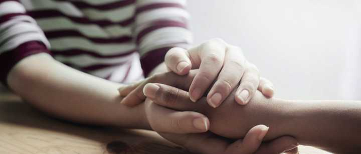 person grasping another person's hand