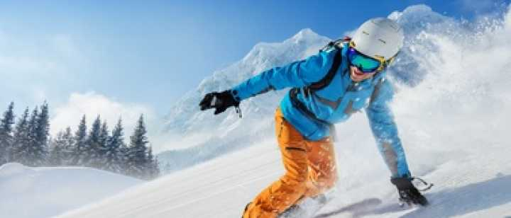 snowboarder riding down the mountain