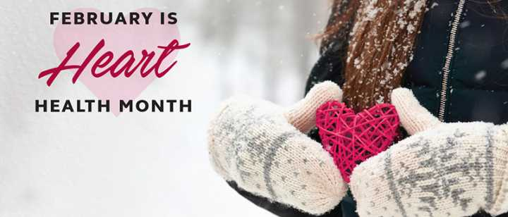 February is Heart Health Month graphic with woman holding a wooden heart