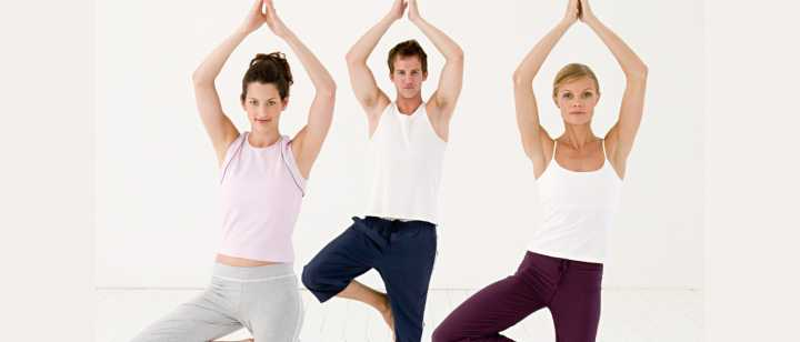3 yogis doing tree pose