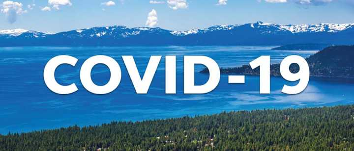 COVID-19 text over a photo of Lake Tahoe