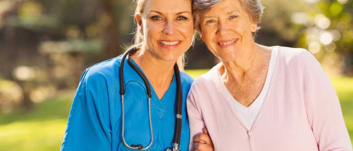 kind nurse with smiling patient