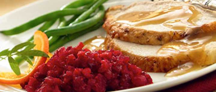 plate with turkey, gravy, green beens, cranberry relish