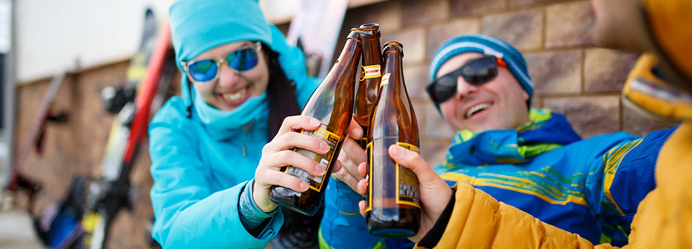 friends with beer on a winter day