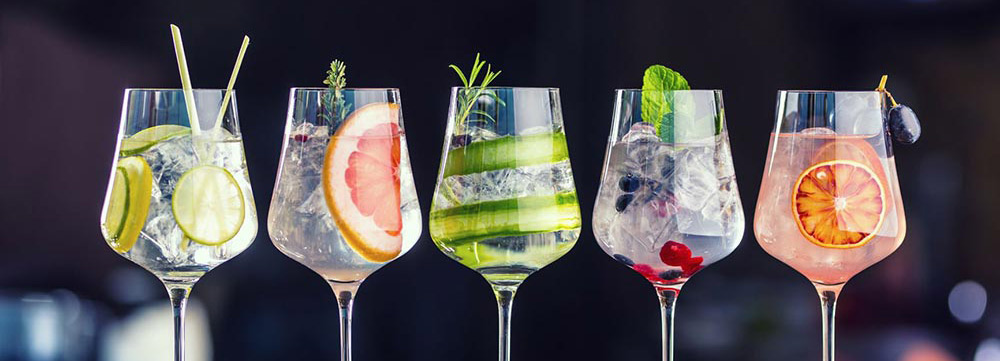 mocktails in wine glasses lined up next to each other
