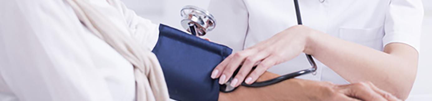 nurse take patient's blood pressure